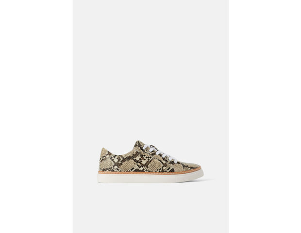 Sneakers con stampa animalier in pitone